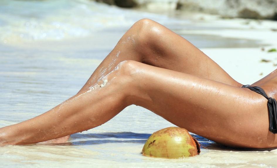 Older vein free legs on tropical beach