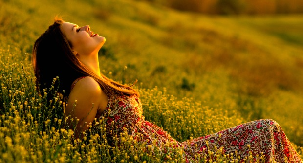 Woman bathing in sunlight in a meadow exemplifies a health-body rightly connected