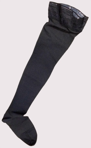Varicose veins stockings showing a black thigh high self supporting stay up top with enclosed toe.