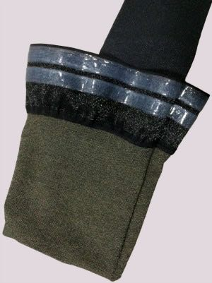 Varicose veins stockings showing a silicone grip top and a cotton with silver thread inner lining.