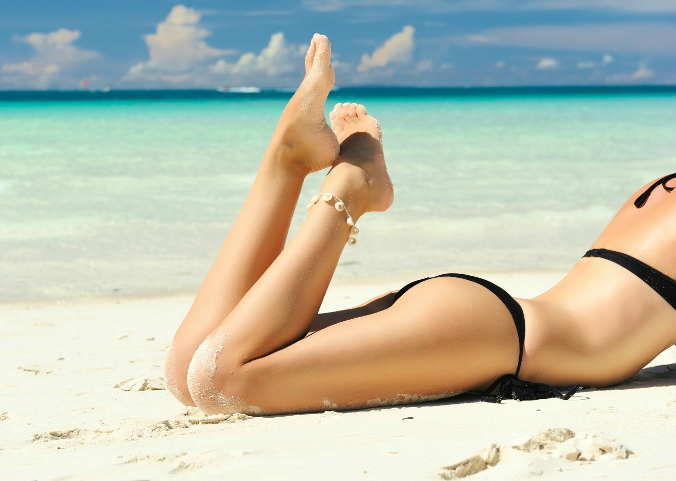 Vein Free Young Legs on Tropical Beach