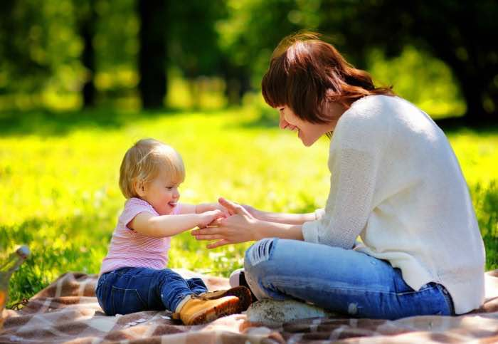 The influence of genetics on varicose veins causes reflected in mother with her baby